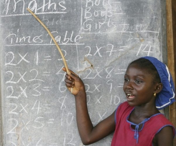 girl points at the blackboard