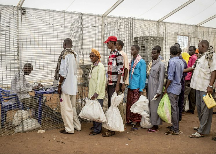 Residents queue for a food rationa at Dedaab Refugee Camp