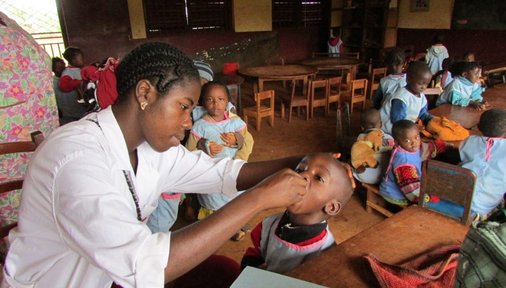 Vaccination team vaccinating children at a nursery school