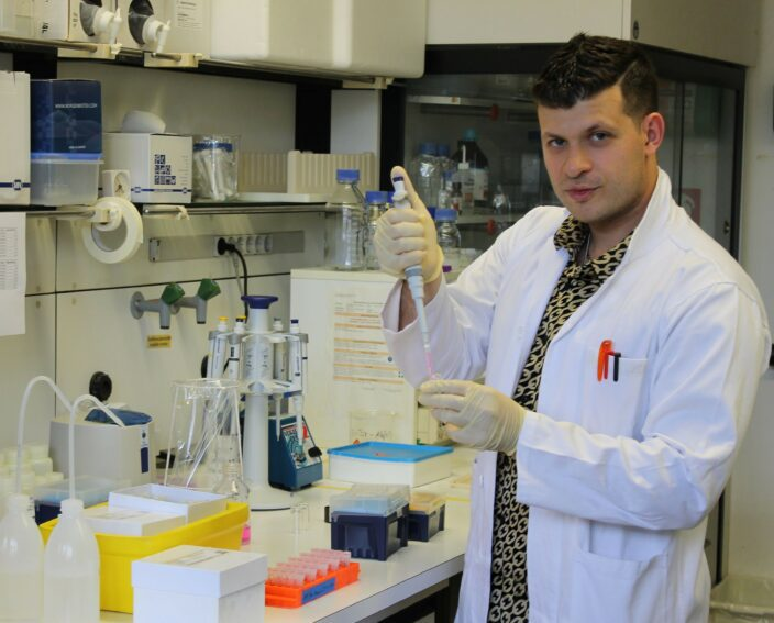 A research scientist in a lab trying to find the link  between diseases causing fungi and small pieces of plastic debris.